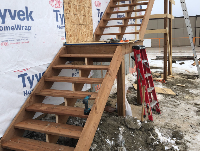 Exterior Two Storey Shop Stairs with Landing