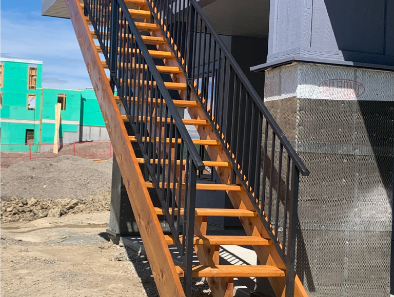Gorgeous Exterior Stairs with Iron Railing